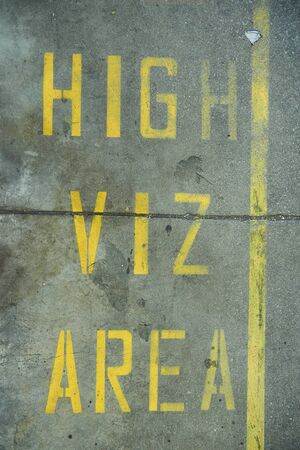 A high viz area floor sign protecting workers in an industrial factory setting. Signs and notification hazard displays keeping people safe from work place hazard and injury. alerting danger.