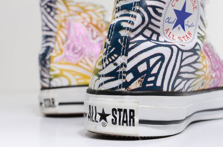 london, england, 05/05/2018 Converse All Star rare Butterfly Hi Top Chuck Taylor trainer shoes. Famous iconic classic converse hi top sneakers on a white background.