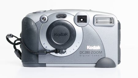 london, england, 05/05/2018 A Retro vintage digital kodak dc280 zoom camera isolated on a white background. vintage hipster style camera making a fashionable come back in youth culture.