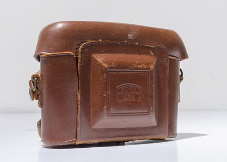 london, england, 05072018 Zeiss Ikon Nettar medium format camera in a leather case.  vintage medium format photographic equipment. Редакционное