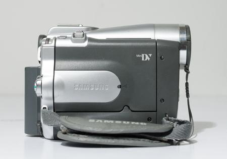london, england, 05/05/2019 A samsung mini dv digital camcorder dig cam recorder. SAMSUNG VP-D93 Mini DV/800 x Zoom LCD Digital Camcorder silver isolated on white studio backdrop. Editorial