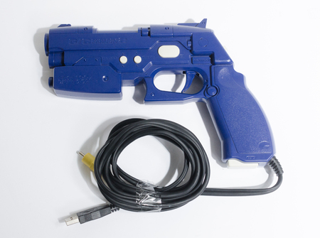 london, england, 02022018 Namco playstation 2 PS2 Namco  System Product 2 Blue Retro Game Gun for Time Crisis game. retro vintage video game joystick