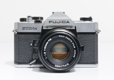 london, england, 05/05/2018 A Retro vintage FUJICA STX 1N 35mm single lens reflex film camera,and 50mm 1.8 lens. vintage hipster camera making a fashionable come back in youth culture.