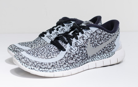 london, england, 05/05/2019 nike free 5.0  light blue snake skin style camo colourway running shoes. modern and stylish lightweight running sneakers. Athletics and marathon equipment.
