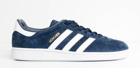 london, england, 05/05/2018  Adidas Munchen gazelle vintage sneaker trainers. Blue suede adidas trainers, stylish retro football street fashion. famous three stripes 版權商用圖片