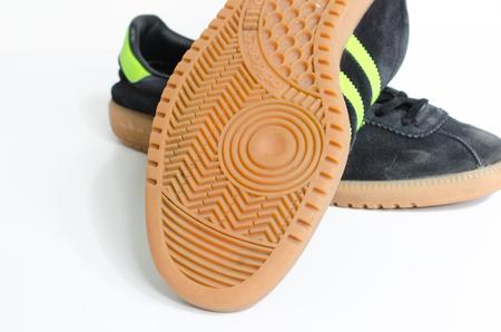 london, england, 05/05/2018  Adidas Originals Bermuda Core Black Green Gum Casuals Not Malmo Dublin Trainers vintage sneaker trainers. stylish retro football street fashion. adidas gum sole