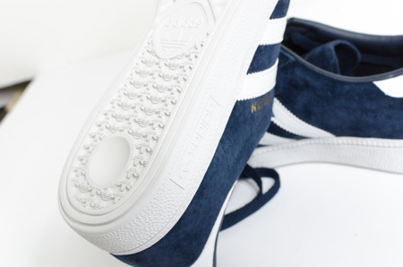 london, england, 05/05/2018  Adidas Munchen gazelle vintage sneaker trainers. Blue suede adidas trainers, stylish retro football street fashion. famous three stripes Editorial