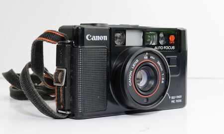 london, england, 05/05/2019  a retro vintage 1990s Canon rangefinder  film camera isolated on a white background. Canon 4.5 lens, old photographic technology analogue. hipster trendy