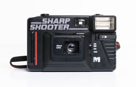 london, england, 05/05/2019  a retro vintage miranda sharp shooter 35 mm film camera isolated on a white background. miranda 33 mm lens, old photographic technology  Banque d'images