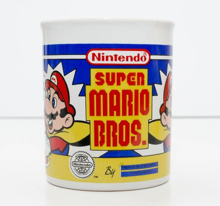 london, england, 05052018 a super mario official nintendo 1990s super mario bros mug coffee cup isolated on a white background. official merchandise.