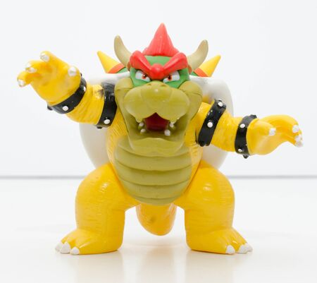 london, england, 05052018 a super mario official nintendo 1990s bowser toy isolated on a white background. official merchandise. bowser mariokart action figure.