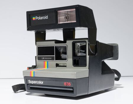 london, england, 05092019 A retro polaroid 635 super colour  camera instant photo film producer. retro hipster fashionable vintage festival cameras. instagram photography feel colour grade.