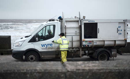 cleveleys, england, 05/05/209 The wyre council bin collections operational in windy storm conditions. Refuse and rubbish collection trucks on the fylde coast in england. Council tax fees.