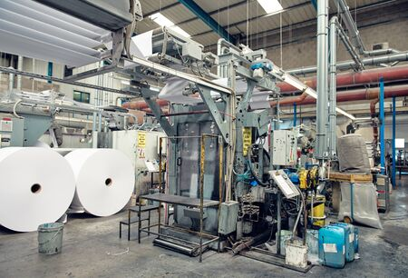 london, eng;land, 29/03/2020 A toilet paper making machine, producing toilet and bathroom paper rolls due to Corona virus panic buying. Paper and tissue manufacturers factory and engineered machinery.