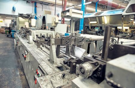 london, uk, 05/05/2019 A industrial commercial envelope making machine, making paper envelopes for international distribution. Automated engineering machinery for mass production of paper envelopes.