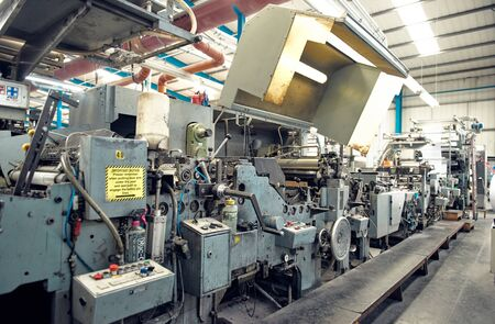 london, england, 29/03/2020 A toilet paper making machine, producing toilet and bathroom paper rolls due to Corona virus panic buying.  Paper and tissue manufacturers factory and engineered machinery.