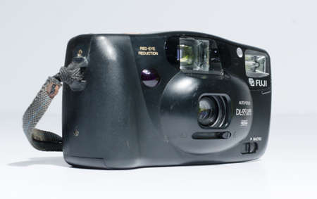 london, england, 05/05/2019  a retro vintage FUJI film dl 95 super panorama multi af zoom 35 mm film camera isolated on a white background. Fuji 35mm lens, old photographic technology