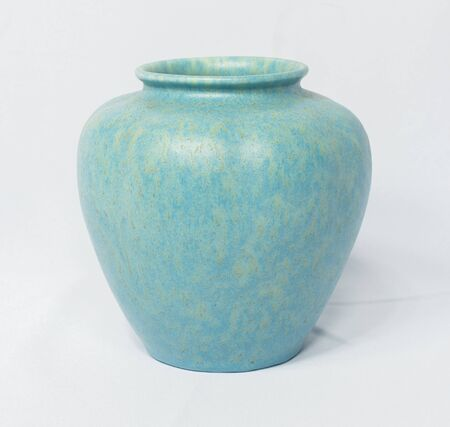 A vintage antique ceramic fragile pottery royal lancastrian 1916 blue and aqua vase isolated on a white background. old pottery pots from the past, found in junk shops and thrift stores.