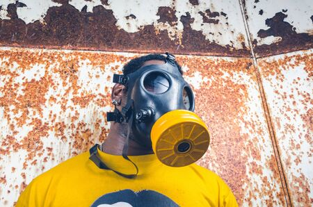 A black male with a military grade gas mask to protect himself from the corona virus covid19. Face mask used to prevent the spread of the virus. Mandatory face coverings.
