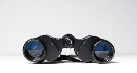 A set of vintage old antique binoculars on a white background. Vintage retro spy ware, distance viewing, peeping and watching birds and nature. Telescopic magnifying glass
