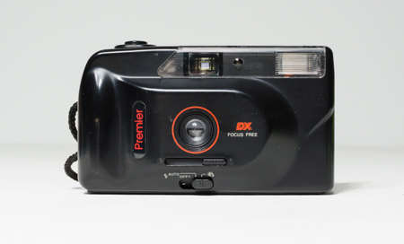 london, england, 05/05/2018 A Retro vintage premier dx  super 35mm film camera isolated on a white background. vintage hipster style camera making a fashionable come back