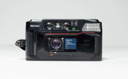 london, england, 05/05/2018 A Retro vintage ricoh ff 70 super 35mm film camera isolated on a white background. vintage hipster style camera making a fashionable come back