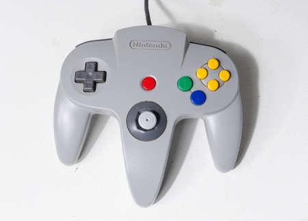london, england, 05/08/2018 A Nintendo n64 grey controller Joystick Controller for Nintendo 64 retro video game joysticks isolated on a  white background. Famous computer joystick controller.