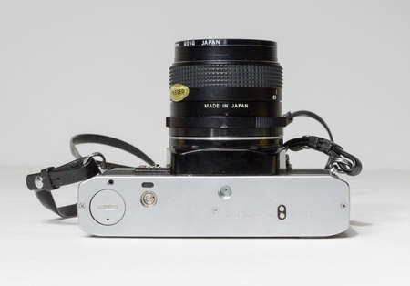 london, uk 05/05/2018 A Retro vintage olympus om 10 35mm single lens reflex film camera and lenses. vintage hipster camera making a fashionable come back in youth culture.