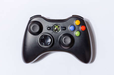 london, uk 05/05/2020 An black futuristic microsoft  xbox 360 controller on a white studio backdrop. collectable rare home arcade video gaming. joystick and wireless remote technology. 新聞圖片