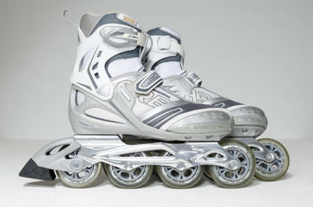 london, uk, 02/02/20202 white rollerblade sfr spark 8kw pro inline fitness skates rollerblades unisex. health and fitness beach promenade skating. cardio exercise skaters blades.