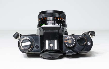 london,uk, 05/05/2019 Black vintage Yashica FR1 SLR Film Camera with 50mm f1.9 Yashica Lens Camera Body isolated on white. Japanese retro vintage classic film camera 新聞圖片
