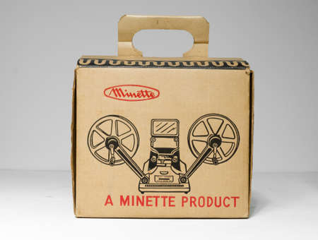 london, uk, 02/02/2020 A minette viewer editor 8mm M - 2 8mm film video reel player. Retro japanese film spool film media. Antique home movie projector media cardboard box.