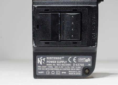 london, UK 05/05/2020 Nintendo n64 Console power supply block on a white isolated background. iconic retro vintage video gaming machine. Japanese technology