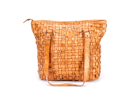 intertwined: Elegant brown handbag sewn from intertwined leather strips isolated on white background, with belt Stock Photo