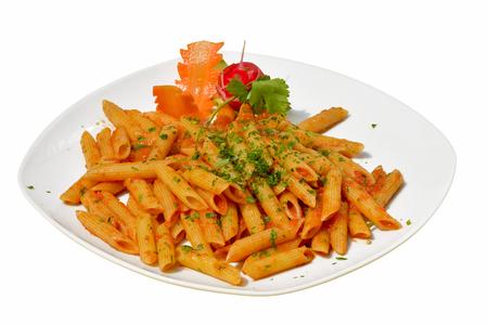 Penne pasta with chili sauce arrabiata on white background Stock Photo