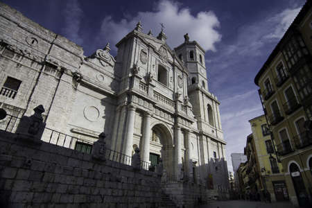 Facade of Valladolid Cathedral with typical buildings, Valladolid, Spain