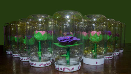 synthetic handmade flowers and introduced into a flask with water