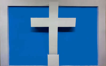 Christian cross of white color, with a blue background and white frame