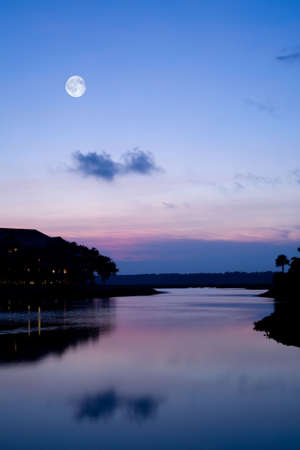 Full moon over a serene lake.  Plenty of Copy Space. Stock Photo - 8078966
