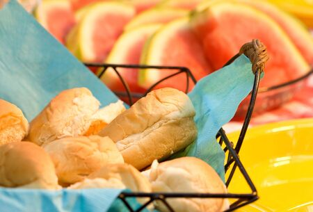 Details of bread rolls and watermelon as part of a 4th of July picnic concept. Stock Photo