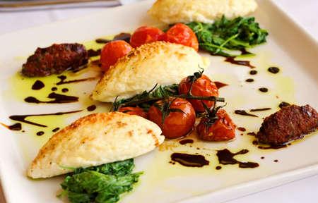 Gourmet Italian Gnocchi, with roasted tomatoes and arugula.
