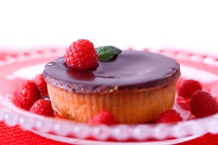 sweet tart: A gourmet chocolate raspberry tart dessert on glass dish. Stock Photo