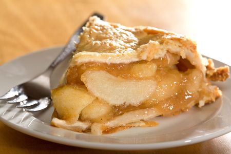 apple pie: Freshly baked deep dish apple pie served on white plate.