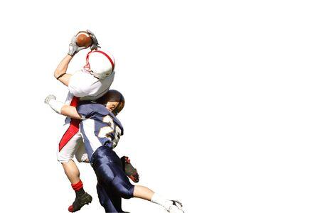 アメリカン フットボールの試合で壮大なキャッチの隔離。 写真素材