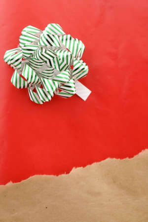 unwrapped: This Christmas concept depicts a mailed package being torn off to reveal a Christmas gift underneath  Stock Photo