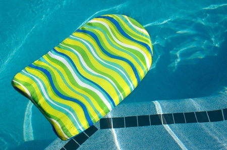 A colorful boogie kick board in swimming pool. Plenty of Copy Space. photo