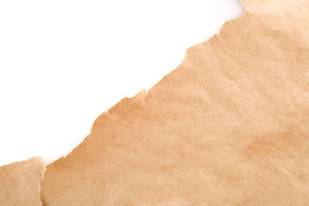 unwrapped: Ripped packaging or gift paper.  Plenty of copy space. Stock Photo