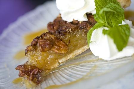 Pecan Pie Dessert, with whipped cream and garnishment. Gourmet Dessert.