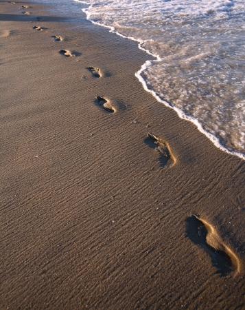 footmark: Footprints in the Sand photo. Great for Beach Vacation concepts, and journey abstract. Stock Photo