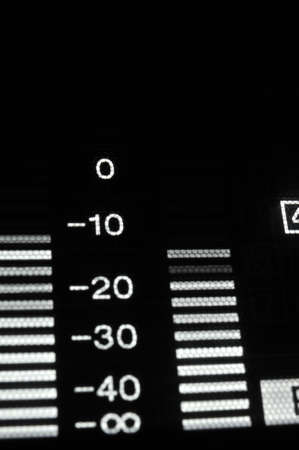 wav: Perspective macro shot of the equalizer display of the professional hdcam video player. Shallow dof. Visible data: sound scale, waves, decibels, digits. Stock Photo
